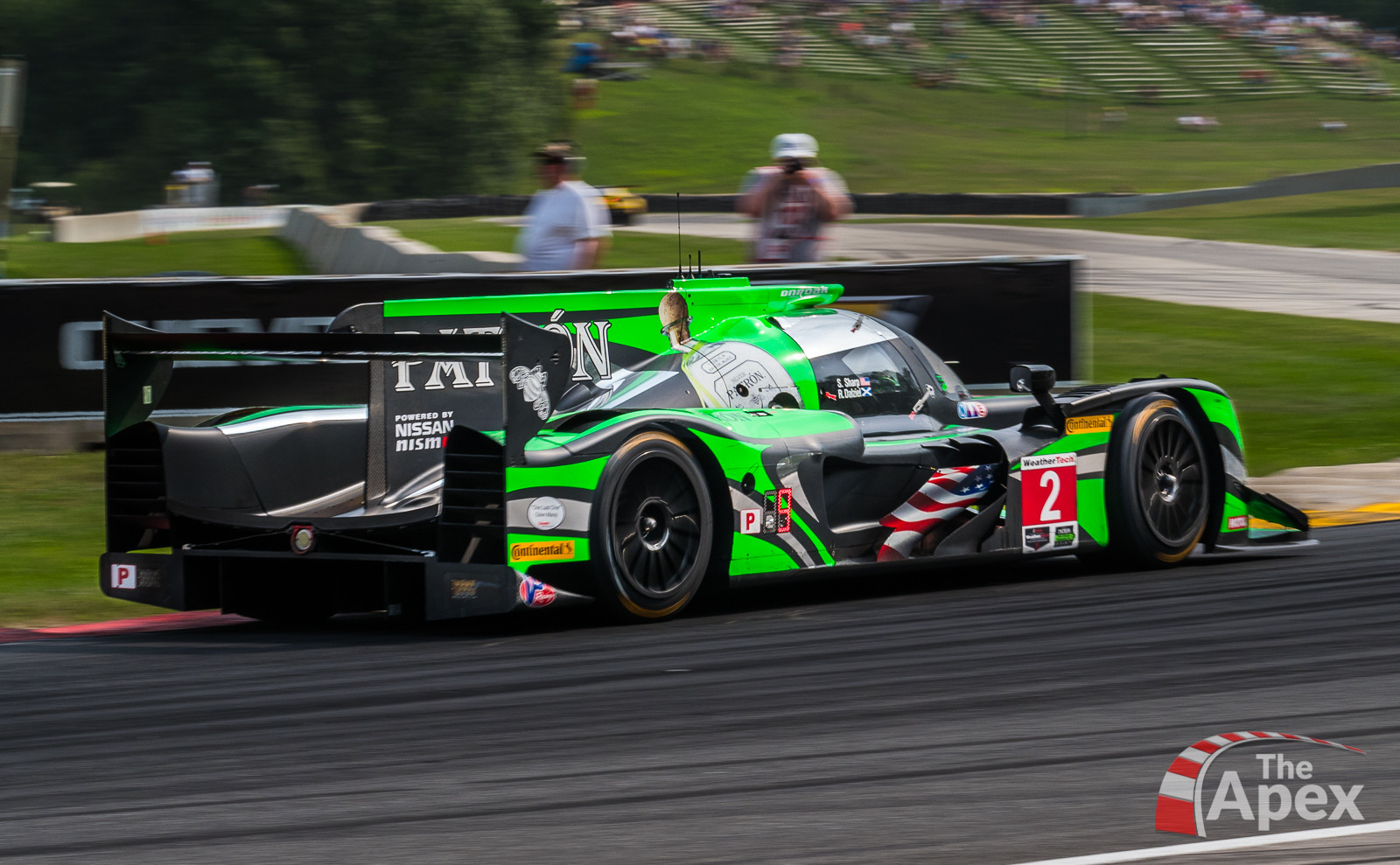 Nissan DPi apexes Turn 6 during Continental Tire IMSA race at Road America