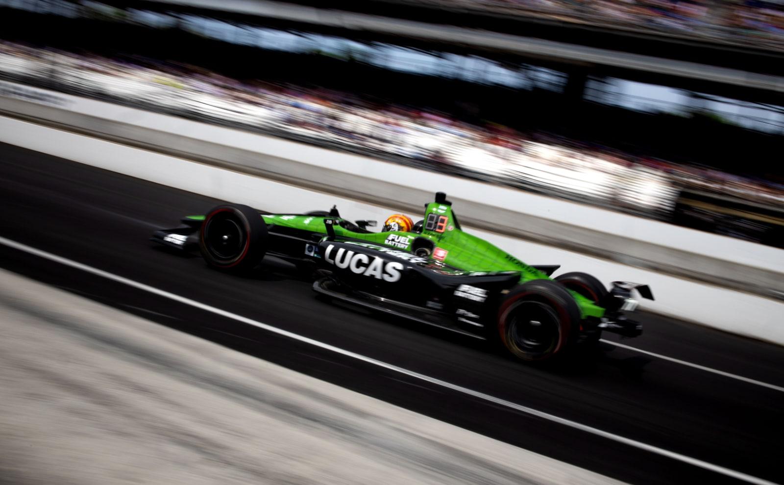 Oriol Servia rolls Lucas SPM Indy car down IMS pit lane