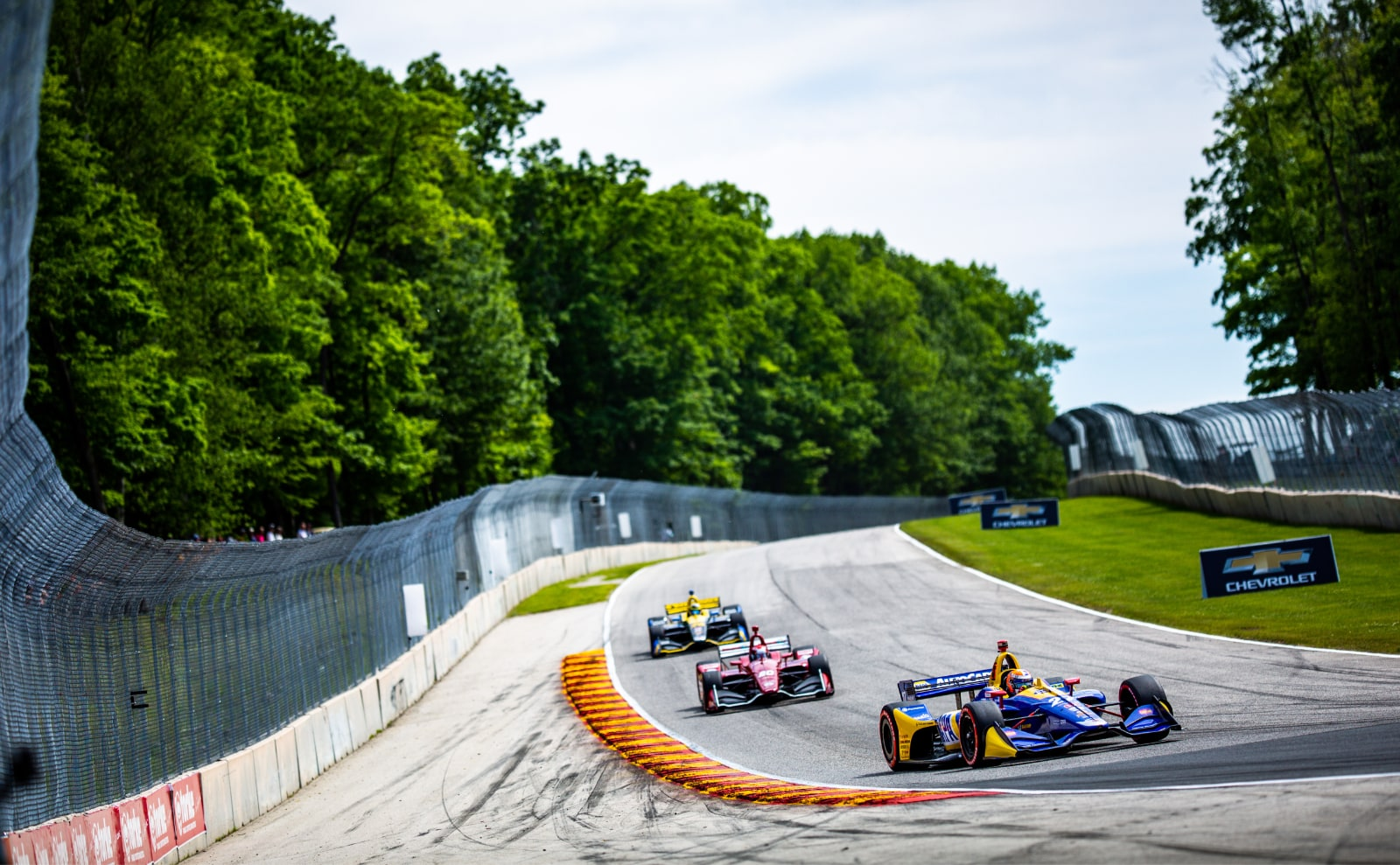 Zach Veach and Ed Jones chase Alexander Rossi at Road America