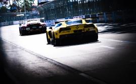 Corvette IMSA race car chases Porsche 911 at Long Beach