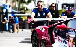 Ganassi IMSA crew members push Ford GT in Long Beach paddock